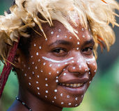 Portrait of Woman Dani tribe in ritual coloring on the body and face. Stock Photos