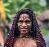 Portrait of Woman Dani tribe in ritual coloring on the body and face. Royalty Free Stock Image