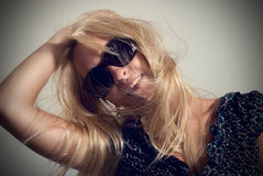 Portrait of woman in dark glasses Stock Photo