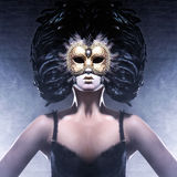 Portrait of a woman in a dark Venetian mask royalty free stock images