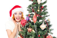 Portrait of a woman decorating a Christmas tree Stock Images