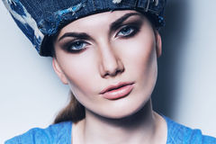 Portrait of woman in denim hat royalty free stock images