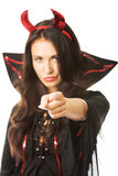 Portrait woman devil clothes pointing on you Stock Photo