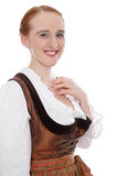 Portrait of a woman in a dirndl. Woman in Dirndl and red hair isolated on white royalty free stock images