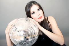 Portrait of a woman with Disco ball Stock Photo