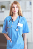 Portrait of woman doctor with folder at hospital corridor Royalty Free Stock Image