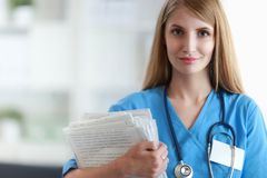 Portrait of woman doctor with folder at hospital Stock Photo