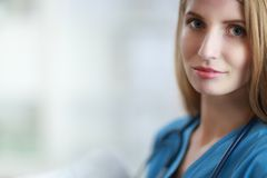 Portrait of woman doctor with folder at hospital Stock Photos