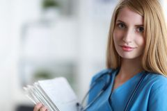 Portrait of woman doctor with folder at hospital Royalty Free Stock Photo