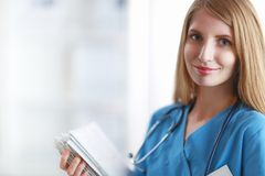 Portrait of woman doctor with folder at hospital Royalty Free Stock Photography