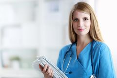 Portrait of woman doctor with folder at hospital Stock Images