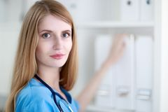 Portrait of woman doctor at hospital corridor Stock Image