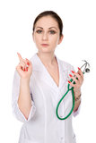 Portrait of a woman doctor with a raised finger Stock Photo