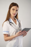 Portrait of a woman doctor with a tablet computer Stock Photos