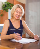 Portrait of  woman with documents Stock Photography
