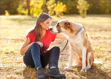 Portrait of a woman and dog in park Royalty Free Stock Photography