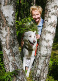 Portrait of a woman with a dog on a walk Stock Photography