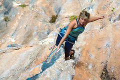 Portrait of Woman doing Exercise on vertical rocky Wall Royalty Free Stock Image