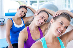 Portrait of woman doing head exercise with her friends Royalty Free Stock Image
