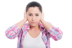 Portrait of woman doing hear no evil gesture Royalty Free Stock Photos