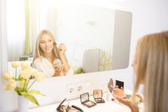Portrait of woman doing makeup Royalty Free Stock Image