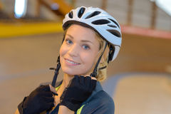 Portrait woman doing up strap cycling helmet Royalty Free Stock Photography