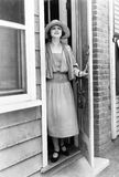 Portrait of woman in doorway royalty free stock photography
