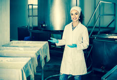 Portrait of  woman dressed in lab coats is looking happy on the Stock Photos