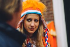 Portrait of woman dressed in orange, crazy hat, King`s Day festivity in the Netherlands. National holiday, important celebration, street festival Stock Photo