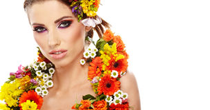 Portrait of a woman dressed in  flowers Royalty Free Stock Photography