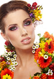 Portrait of a woman dressed in  flowers Royalty Free Stock Photo