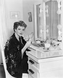 Portrait of woman at dressing table stock photography