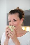 Portrait of a woman drinking coffee Royalty Free Stock Image