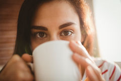 Portrait of woman drinking coffee Royalty Free Stock Images