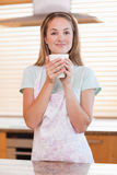 Portrait of a woman drinking a cup of tea Royalty Free Stock Image