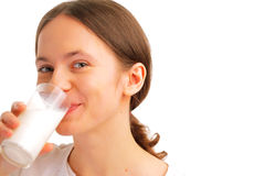 Portrait of woman drinking milk Stock Photos