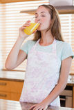 Portrait of a woman drinking orange juice Stock Photography