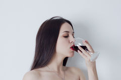 Portrait of woman drinking red wine Royalty Free Stock Photos