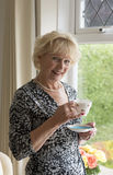 Portrait of a woman drinking tea Stock Image