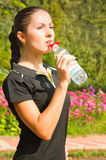 Portrait woman drinking water Stock Image