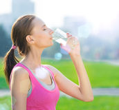 Portrait of woman drinking water after sport Royalty Free Stock Images