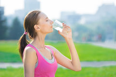 Portrait of woman drinking water after sport stock photo