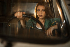 Portrait of woman driver behind steering wheel of car. View thro Stock Photography