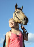 Portrait of a woman and a dun horse Royalty Free Stock Photos