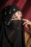 Portrait of a woman in east style. Middle eastern culture: belly dancer with traditional veil Royalty Free Stock Images