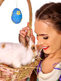 Portrait woman with easter rabbit in basket. Royalty Free Stock Image
