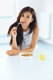 Portrait of woman eating cereals. Healthy eating. Health care. W Stock Images