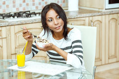 Portrait of woman eating cereals. Stock Photography
