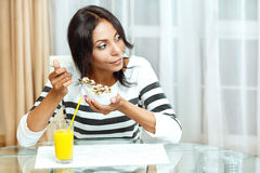 Portrait of woman eating cereals. Royalty Free Stock Photography