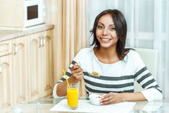 Portrait of woman eating cereals. Stock Photos